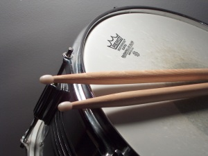 A drum and drumsticks