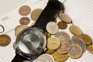 A watch and coins