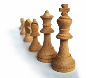 a row of chess pieces ordered in descending rank